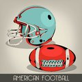 Blue american football helmet and red ball Royalty Free Stock Image