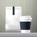 Blue anchor coffee cup and food paper bag breakfast set Royalty Free Stock Photo