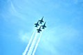 Blue angels flying through the clouds Royalty Free Stock Photo