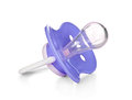 Blue baby silicone pacifier Royalty Free Stock Photo