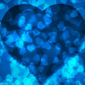 Blue background blurred lights heart of in the shape of a Royalty Free Stock Image