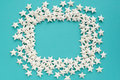 Blue background. Frame made of white stars Royalty Free Stock Photo