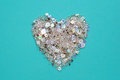 Blue background with heart of sequins and beads