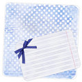 Blue background with note paper and bow Stock Photo