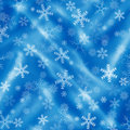 Blue background with snowflakes and drapery christmas Royalty Free Stock Photo