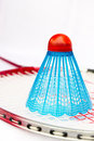 Blue badminton shuttlecock on the racket Stock Images