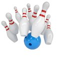 Blue ball knocks down pins for bowling Royalty Free Stock Photo