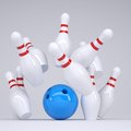 Blue ball knocks down pins for bowling Royalty Free Stock Photography