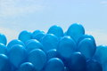 Blue balloons on the sky background Royalty Free Stock Photo
