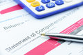 Blue ballpoint pen on a company's statement of comprehensive income. Royalty Free Stock Photo