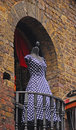 Blue based dress with white polka dot displayed on a balcony around camden market Stock Photos
