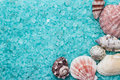 Blue bath salt and seashells Royalty Free Stock Images