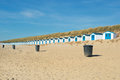 Blue beach huts row and white cabins for vacation surpose Royalty Free Stock Photography