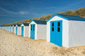 Blue beach huts row and white cabins for vacation surpose Stock Photography