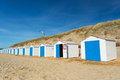 Blue beach huts row and white cabins for vacation surpose Royalty Free Stock Image