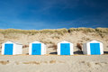 Blue beach huts row and white cabins for vacation surpose Stock Images