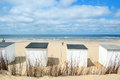 Blue beach huts at texel row and white cabins for vacation Stock Photo