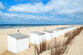 Blue beach huts at texel row and white cabins for vacation purposes Stock Photo