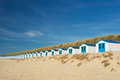 Blue beach huts at texel row and white cabins for vacation surpose Royalty Free Stock Images