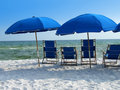 Blue beach umbrellas Stock Images