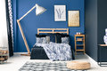 Blue bedroom with gold accents Royalty Free Stock Photo