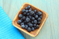 blue berries in wooden bowl with napkin Royalty Free Stock Photo