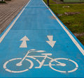 Blue bike lane with white picture Stock Photos