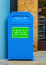 Blue bin public for keeping the are clean Stock Photo