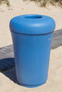 Blue bin on sand Stock Photography