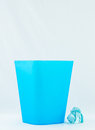 Blue bin for trash of office or home Royalty Free Stock Photo