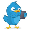 Blue bird holding tablet pc clipart picture of a cartoon character Royalty Free Stock Image