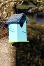 Blue birdhouse at a tree in springtime Royalty Free Stock Image