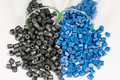 Blue and black polymer pellets in test tubes laboratory Royalty Free Stock Photo