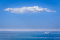 Blue in blue marine scene with the ship and cloud Royalty Free Stock Images