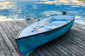 Blue boat with water reflection sunset Royalty Free Stock Photos