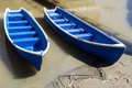 Blue boats two fishing side by side Royalty Free Stock Images