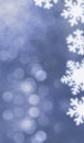 Blue bokeh background with snowflakes Stock Photos