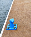 Blue bollard in the harbour of la spezia Royalty Free Stock Images