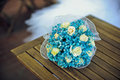 Blue bouquet on a wooden table