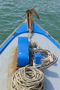 Blue bow of a boat and a rust anchor Royalty Free Stock Images