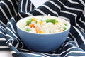 Blue bowl with cooked rice with mixed vegetable Royalty Free Stock Photography