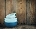 Blue bowls on wooden background with copy space Stock Photos