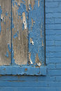 Blue brick wall with wood and peeling paint. Royalty Free Stock Photo