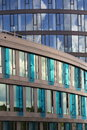 Blue brise soleil sun breakers on modern office glass building Royalty Free Stock Photo