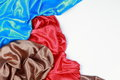 Blue and brown and red silk satin cloth of wavy folds texture ba Royalty Free Stock Photo