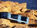 Blue building pallet in mykonos discarded on the coast Stock Photos