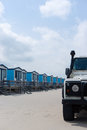 Blue cabanas for rent on a sandy beach with a 4x4 Royalty Free Stock Images