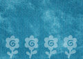 Blue canvas texture with shapes of flowers Royalty Free Stock Photos