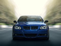 Blue car fast speed drive on city road Royalty Free Stock Photo