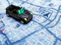 Blue car over map Royalty Free Stock Photo